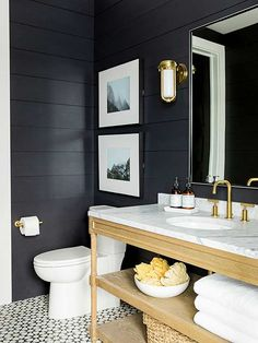 dark hued painted bathroom with white accents