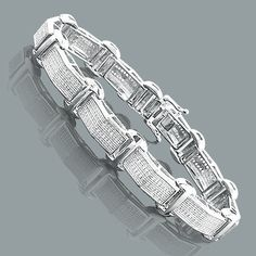 This Sterling Silver Mens Diamond Bracelet weighs approximately 26 grams and showcases 0.59 carats of genuine diamonds. Featuring a versatile design and a luxurious rhodium plating for extra shine, this men's diamond bracelet is a great alternative to gold jewelry.