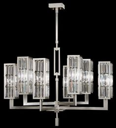 Fine Art Lamps Crystal Enchantment 815440ST Chandelier in a modern design of multi-faceted crystal panels, set in silver-leafed metal frames that refract light and create an enchanting aura highlighting appointments and transforming a space with extraordinary effect.