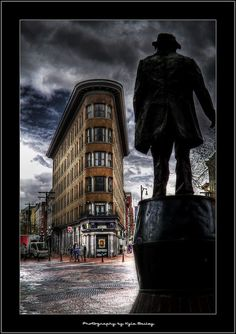 Looking towards the Hotel Europe located at 43 Powell Street (at Alexander) in Vancouver's historic Gastown stands a statue of John Deighton (Gassy Jack) who the area is named after.
