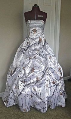 White camouflage wedding dress.  This is just too awesome to not pin it where we can find it later. I like it more for a prom or formal event. Next masked ball? Mardi gras? Add a splash of red bird. fabulous and whimsical. :)
