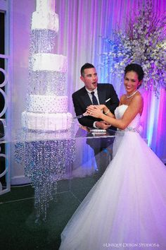 Melissa and Dean's amazing bling cake top with hanging crystal chandelier. Wedding and design by Tiffany Cook Events
