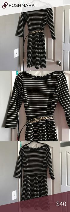 Banana Republic Striped Ponte Dress w Pockets So sad, but it's time to let this one go because I don't think I'm going to fit into it again. It's the perfect dress! I've already sold the other colors I owned in it. The stripes are perfectly chic and figure flattering. I loved mixing prints with it like this leopard belt. Looks good with wide belt also or no belt. Heavy fabric that's figure flattering. Pockets! 3/4 Sleeve! Banana Republic Dresses