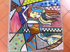 Stained glass mosaic. grouted with white and gray colors.In a Romero Britto style.