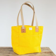 No. 103 Campus Tote in lemon duck canvas and Horween leather. Handmade in Omaha, Nebraska. Lifetime guarantee.