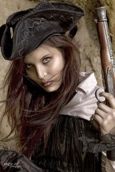 Interesting representation. Not sure what she's wearing. The two documented women pirates, Anne Bonny and Mary Reed, dressed as men and convincingly so. No one but the captain, Calico Jack, knew they were women. C. J. http://ladybladeblog.wordpress.com/