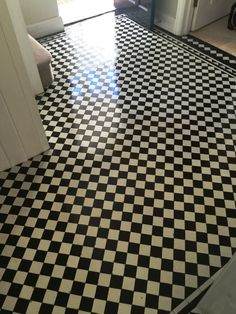Victorian floors are known for their intricate and interesting patterns – so when tiles are in need of replacement, sourcing ones which are consistent with original pattern can be a difficult task.  This was the case when recently I quoted for a clean and seal of a large black and white Checkered Victorian tiled hallway at a property in the town of West Byfleet, Surrey. The customer informed me they had engaged a tiler to lay black tiles in the door thresholds to match the others.