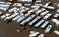 A line of recreational vehicles sit submerged by floodwaters of Tropical Storm Harvey near Vidor, Texas