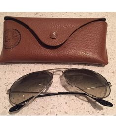Ray-ban aviator sunglasses silver Great pair of aviator sunglasses. Bought at barneys NYC - worn but overall good condition!!! Silver color. Comes with original case- has a small crack on flap(see photo) Ray-Ban Accessories Sunglasses