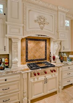 Romanesque Liner and Avignon were used in this elegant backsplash! www.landmarkmetalcoat.com