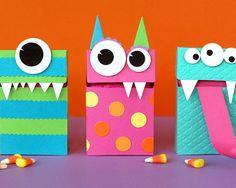 Monster Treat Bags. They might look wild, but filled with treats, they're definitely sweet on the inside! The easy method to create them--fill a paper sack with treats, then fold the top over, forming the face area. Decorate as shown, or design your own little monster creations.