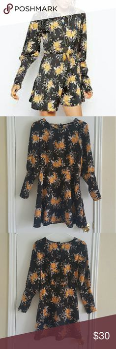 FREE PEOPLE Parker Long Sleeve Skater Dress NWT Beautiful boho floral dress with button back detail. Missing two buttons in the back but tag comes with extra button Free People Dresses Long Sleeve