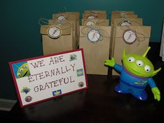 Toy Story Birthday Party Favor Bags  Pizza planet bagel bites Slinky dog hot dog bites Sheriff cut sandwiches ? Activity corner with stickers and coloring book pages with pails