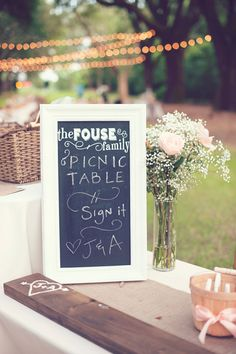 picnic table guest book http://www.weddingchicks.com/2013/09/27/pink-and-cream-wedding/