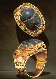 Tut Exhibit - King Tutankhamun Exhibit, Collection: Jewelry - Gold Bangle with Openwork Scarab Encrusted with Lapis Lazuli representing King Tutankhamun