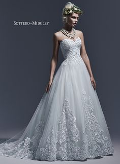 Undeniably elegant ball gown of lightweight tulle and striking embroidered lace, Dawnelle by Sottero and Midgley.