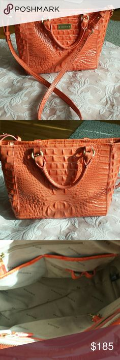 Brahmin bag Beautiful Brahmin and bag this is an orange  peach color it is approximately 10 inches across at the bottom 12.5 inches across at the top with a 9 inch length 21 inch drop on the handle one pocket on the outside zip closure  2 zip pockets on the inside 2 regular pocket with pen holders and one key fob nice and clean on the inside slight wear on one corner where it is pictured  beautiful bag, feet on the bottom comes with a dust bag Brahmin Bags