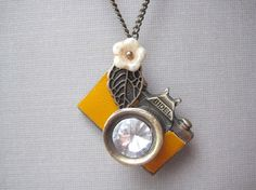 Camera Necklace... @Julie Pinola, we need to find this for you!! So cute!