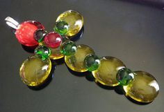 Yellow, Red & Green Cross with Red Glass Center - Made from Glass Pebbles and Tac Fused with Glass Dots by goosecrossingfarm, $14.00  https://www.etsy.com/listing/194990455/yellow-red-green-cross-with-red-glass?
