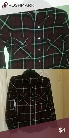 Dark red flannel It's in good condition but missing a button on sleeve to cuff up mid-sleeve  (but you can still roll it up) perfect if you can sew a button Charlotte Russe Tops Button Down Shirts