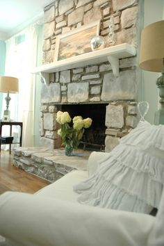 I promised you earlier this week that I would share some of the details from my recent coastal living room makeover, so let's start with the amazing fireplace makeover! Living Room Renovation, Home, Living Room With Fireplace, Room Renovation, Stone Fireplace Makeover, Coastal Living Rooms, Shabby Chic Fireplace, Fireplace, Painted Rock Fireplaces