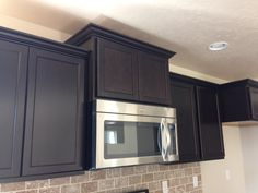 Elevated micro hood cabinet showing twilight cabinet finish and upgraded stainless steel microwave on Sundance 2710