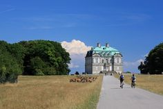 Pedal past the Hermitage Palace in picturesque Dyrehaven (The Deer Park) just north of Copenhagen. Dyrehave is noted for its large populations of red and fallow deer and is a favorite leisure spot for Danes.