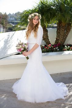 Modest lace dress with long lace sleeves from Avenia Bridal