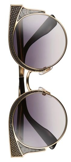These Jimmy Choo sunglasses feature chic gradient lenses in a slender matte frame with eye-catching embossed details.