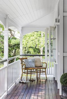 Queenslander veranda: white painted wood railing/balustrade, timber decking, white wood panelling on ceiling, French windows, leafy outlook Home, Porch Swing, House Exterior, Veranda Railing, New Homes, House Colors, White Porch, House, Hamptons Style Homes