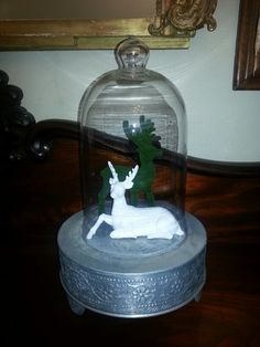 Love me little reindeers happy in their cloche on an indian cake stand www.heyjidesbarn.co.za for BEST IDEAS IN DECOR!