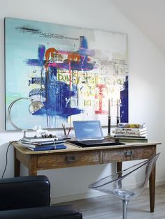 wood desk + colourful abstract art + acrylic chair via interior magasinet.LOVE THE MIX. Garden Lounge Chairs, Acrylic Chair, Big Wall Art, Workspace Design, Office Workspace, Colorful Abstract Art, Cool Tables, Workspace Inspiration, Decoration