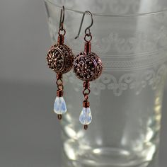 Vintage-inspired earrings featuring meticulously handcrafted copper beads from India.  By Jennifer Sadler Designs.