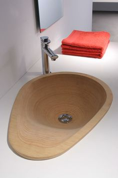 Lavab´ou is a washbasin produced in plywood and in resin, desinged by ebualà, disseny industrial i grafic