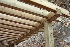 The wooden pergola is a good solution to add beauty to your garden. If you are not ready to spend thousands of dollars for building a cozy pergola then you may devise new strategies of trying out something different so that you can re Garage Pergola, Pergola Swing, Outdoor Pergola, Pergola Plans, Diy Pergola, Pergola Ideas, Small Pergola, Gazebo, Wooden Pergola Kits