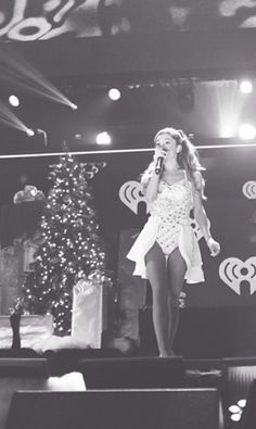 Ariana Grande shows off her Miley Cyrus-inspired style at Jingle Ball in New York!