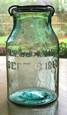 The first is a quart NM Hemingray Wax Sealer, PATENTED SEPT 18 1860. Originally found in an old shed covered with grime. The original tin top and wire closure was still in place. Just a wipe down revealed what a beautiful jar this turned out to be. | eBay!