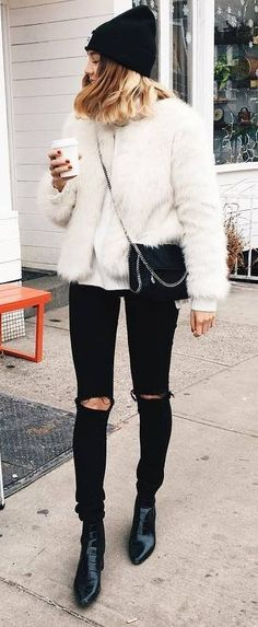 black and white fall outfit idea hat + rips + boots + sweater + jacket