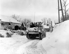 Men of Company I, 3d Battalion, 16th Infantry Regiment, US 1st Division riding on M4 Sherman tank at Schopen, Belgium, 21 Jan 1945