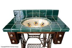 Antique sewing machine table - tile work lavatory sink. Out of my snack bracket, but brilliant creative work nonetheless.