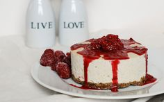 In this recipe for raw cheesecake, a melt-in-your-mouth white chocolate filling with a raspberry garnish sits atop a nutty vanilla crust.