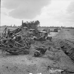Wrecked German transport and knocked out tanks on a road in the Falaise-Argentan area, 21 August 1944.