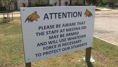 A sign outside a Texas high school warns that teachers may be armed and they…