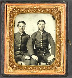 Confederate Brothers Private Stephen D. and Private Moses M. Boynton of Co. C, Beaufort District Troop, Hampton Legion South Carolina Cavalry Battalion, with pistol -Library of Congress