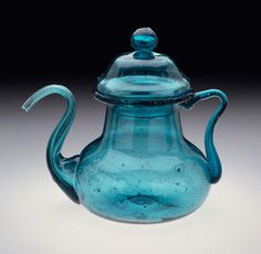 Teapot with Lid | LACMA Collections Teapot with Lid India, Gujarat, Kapadwanj, circa 1750-1800 Furnishings; Serviceware Green glass Overall: Height: 3 5/8 in. (9.21 cm), Diameter: 4 1/8 in. (10.48 cm); Lid: Height: 1 3/4 in. (4.45 cm), Diameter: 1 7/8 in. (4.76 cm); Teapot: Height: 2 1/2 in. (6.35 cm), Diameter: 4 1/8 in. (10.48 cm) Museum Acquisition Fund (M.89.83.2a-b) South and Southeast Asian Art