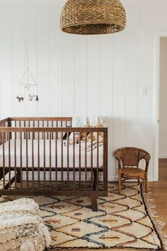 baby room, wicker, vintage rug, white v-groove
