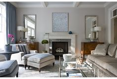 Pale blue ceiling, white coffers, neutrals and blues, comfy looking furniture.