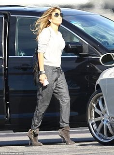 She's got the look: The On The Floor hitmaker donned a white sweater with the sleeves rolled up, dark grey trousers and a pair of grey suede booties