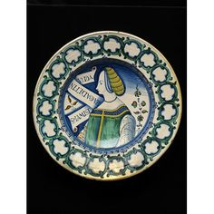 Dish ~ Deruta, Italy ~ 1530-50 ~ This type of large dish called piatti da pompa were produced in Deruta for most of the 16th century. They often show the same idealised portraits of women, inspired by the paintings of Perugino and Pinturicchio. Commonly have scrolls with moral inscriptions and proverbs, in Latin or Italian.The motto on this dish MISERIA CARET INVIDIA (only misery is not envied).