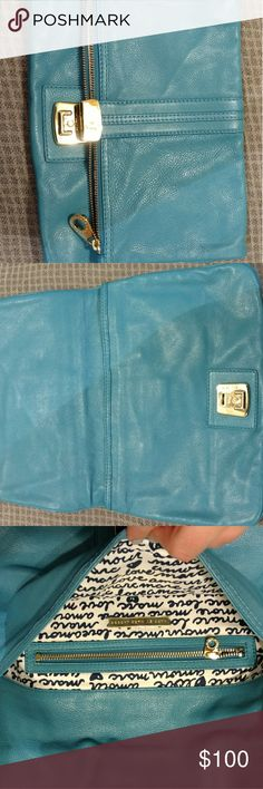 """Blue leather oversized fold over marc jacobs clutc This soft leather blue fold over clutch is perfect for spring and summer. It has tons of room and multiple pockets. Gold hardware and beautiful inside. Like new only wore a few times. L 14"""" Depth 10"""" Marc Jacobs Bags Clutches & Wristlets"""